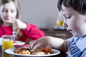 Children eating a full english breakfast
